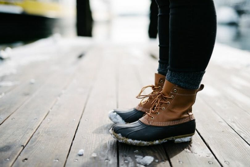 Woman in all weather boots on a wooden dock