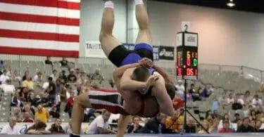 Inverted wrestler wearing nike wrestling shoes