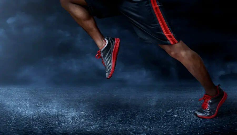 Mens running shoes on asphalt road