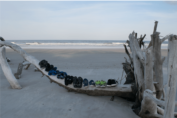 Water shoes lined up on the beach for testing
