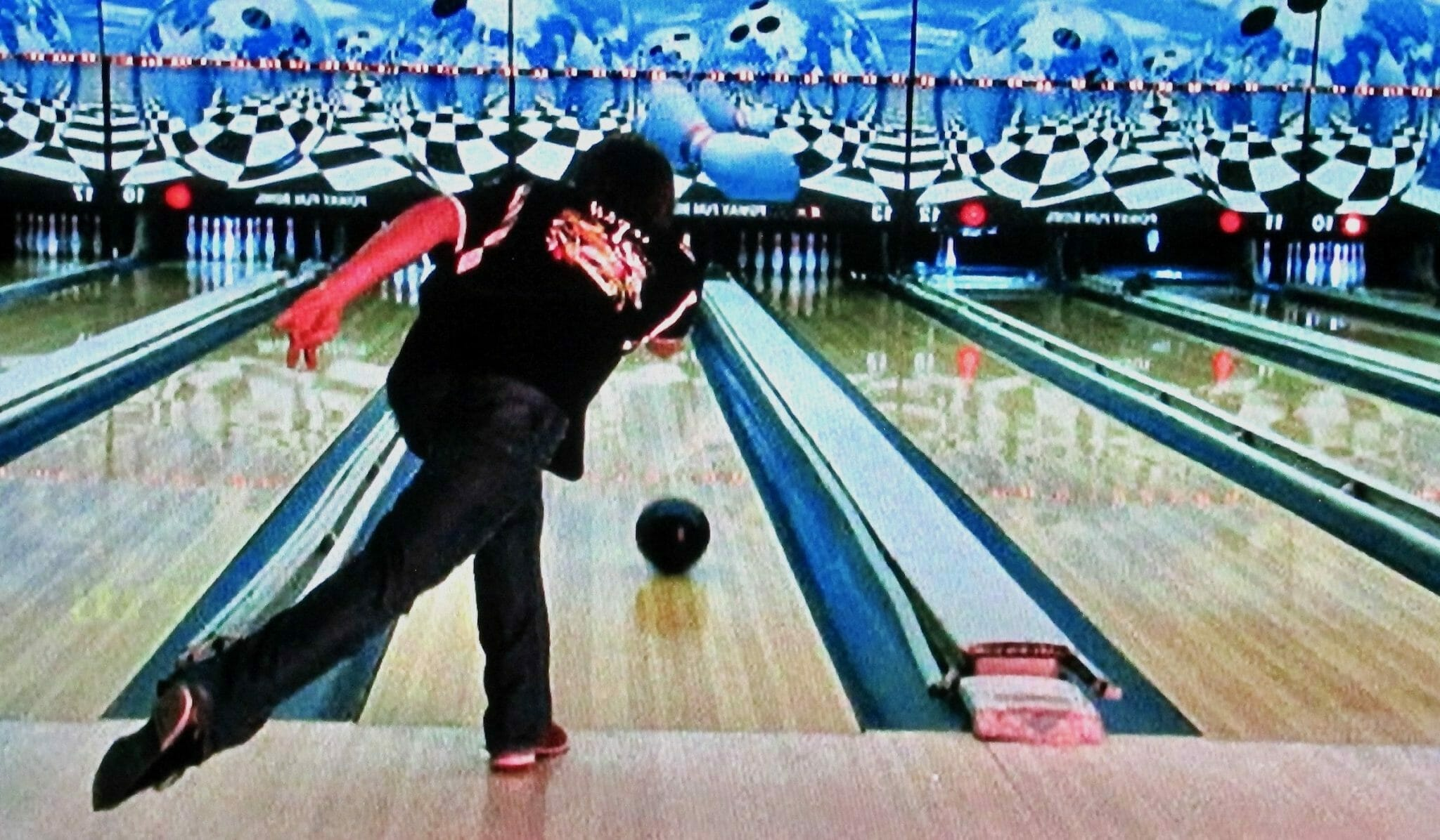 View of bowler rolling a strike