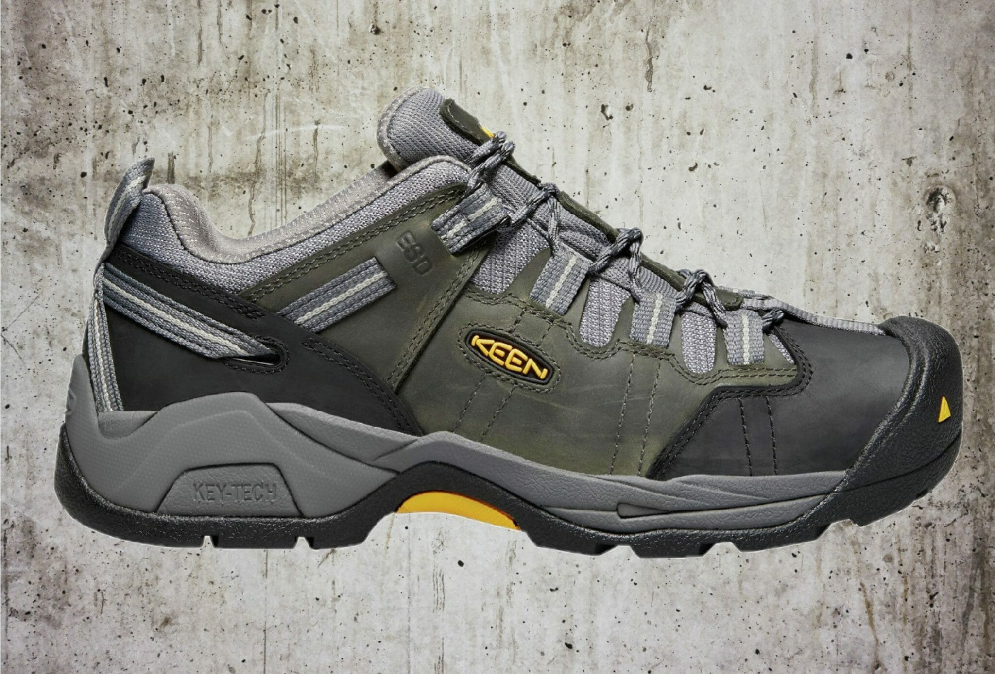 Profile view of the Keen Utility Detroit XT Low top work shoe on backdrop of concrete floor