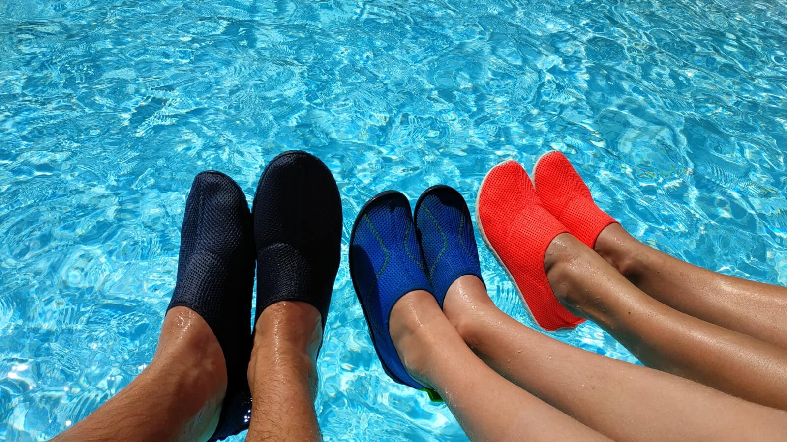 Family testing out a variety of water shoes at the swimming pool
