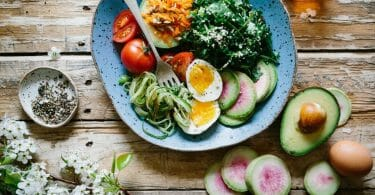 Healthy diet for wrestlers image featuring spinach, eggs, and avocado