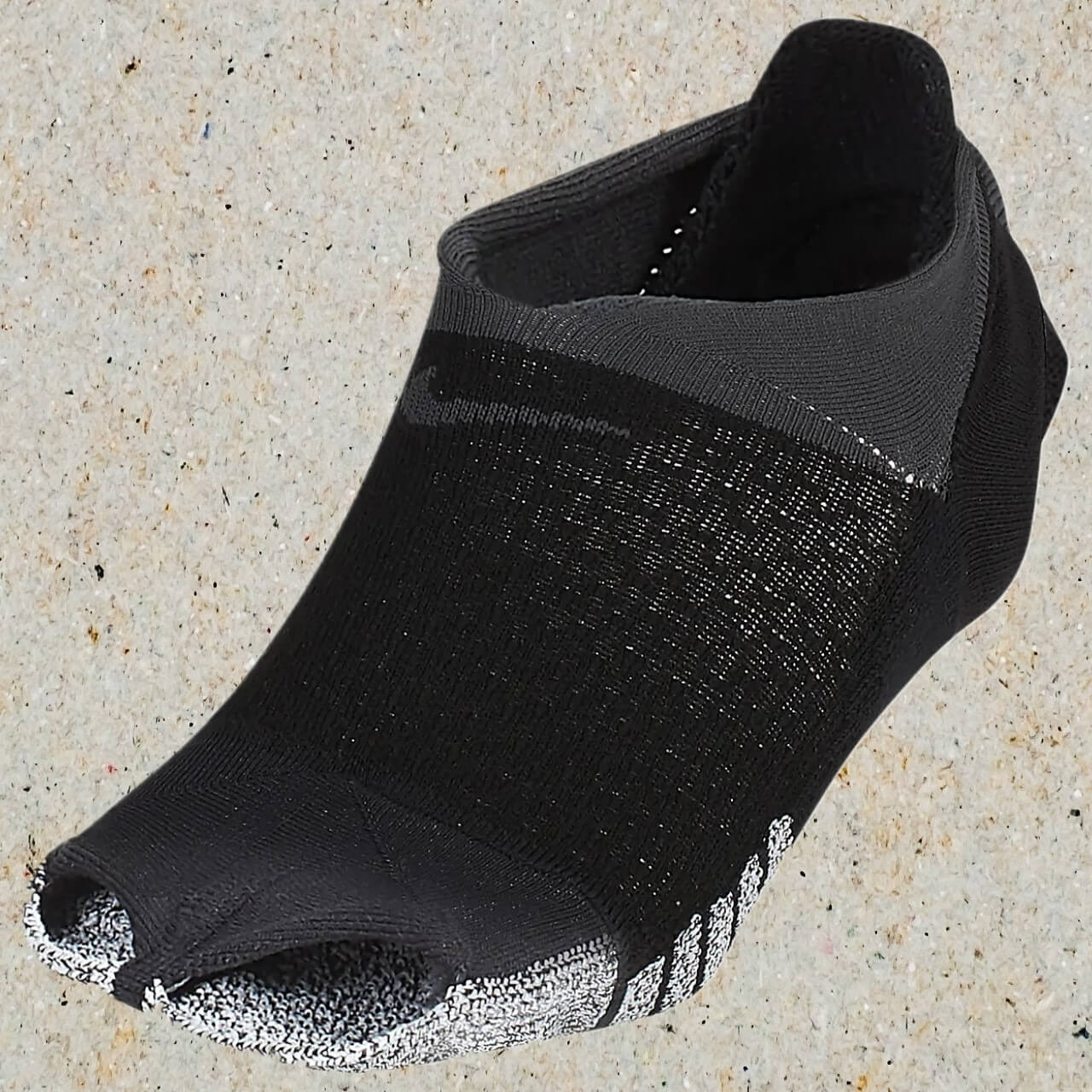 NikeGrip studio grip footie socks for yoga and meditation.