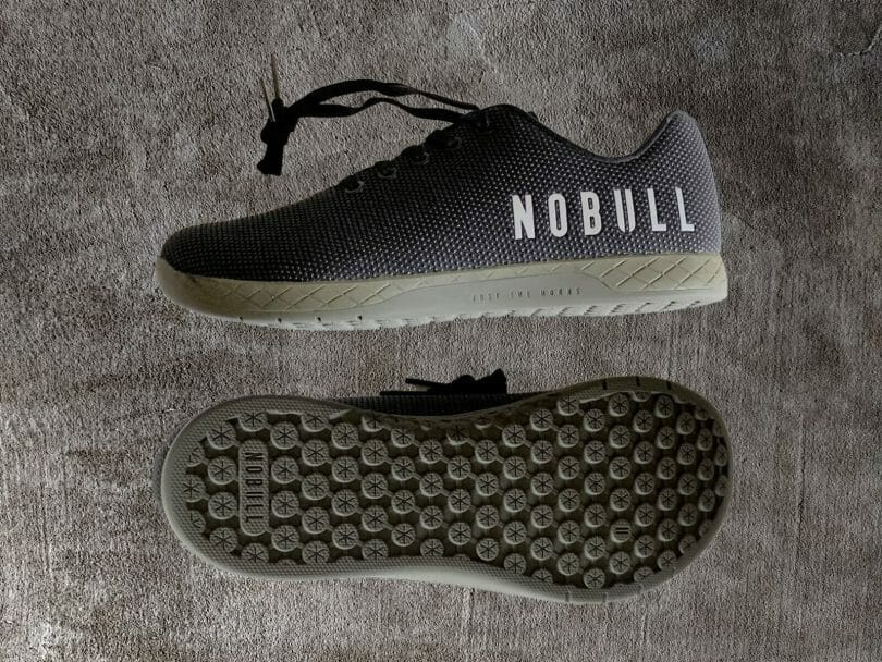 NoBull black trainers with details of profile and outsole.