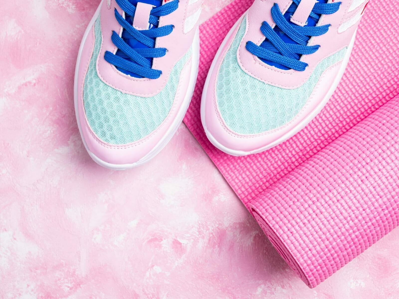 Variations on pink with shoes, mat, and floor.