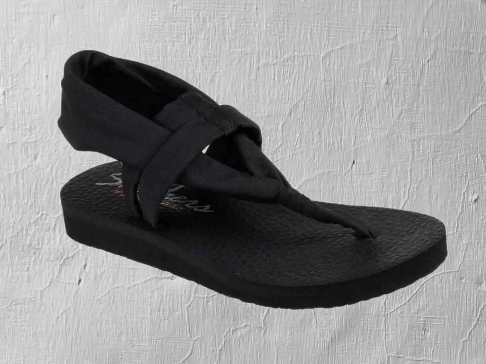 Skechers meditation studio kicks black sandal with foam cushioned sole.