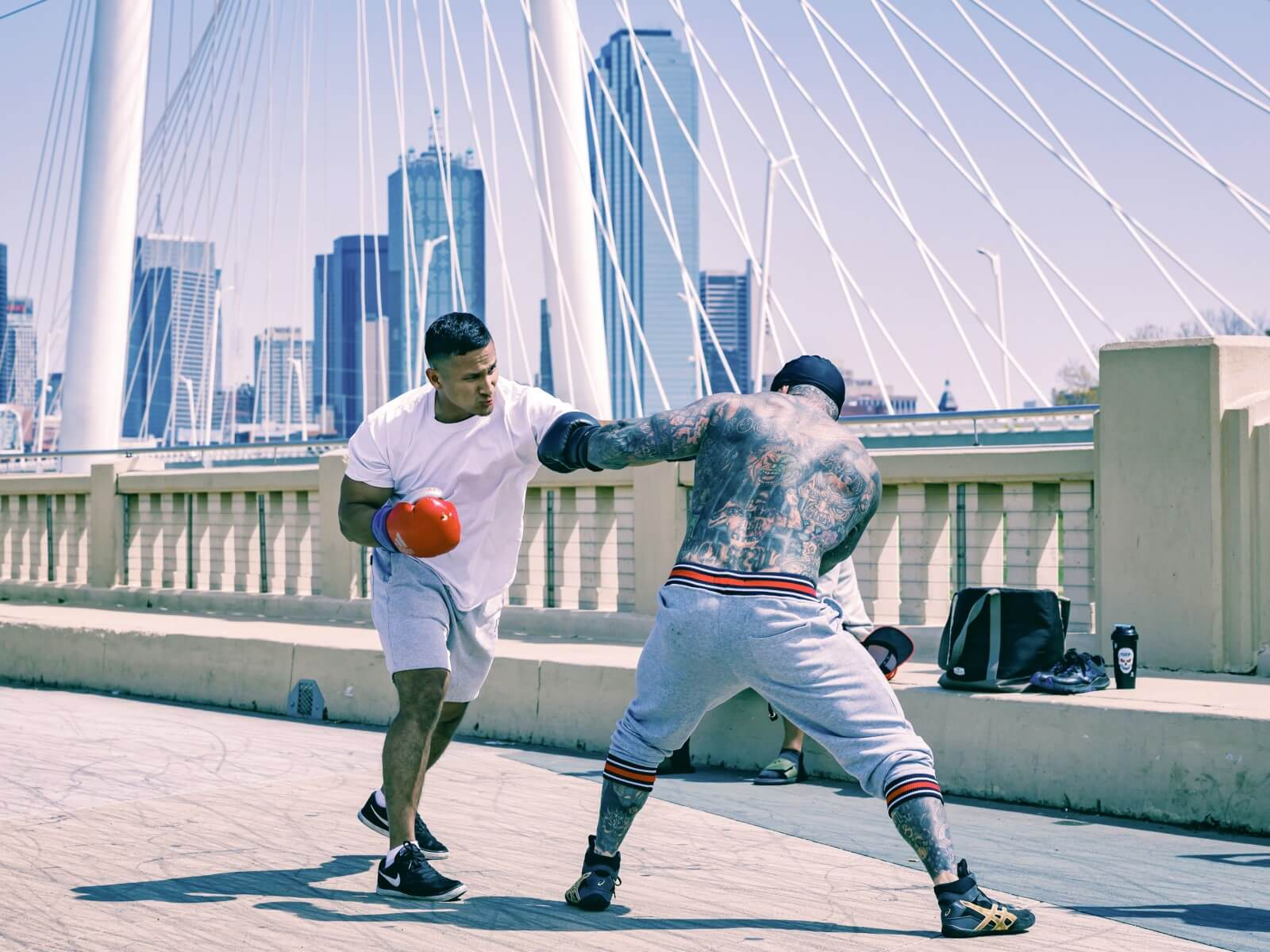 Two men sparring on a bridge in Dallas
