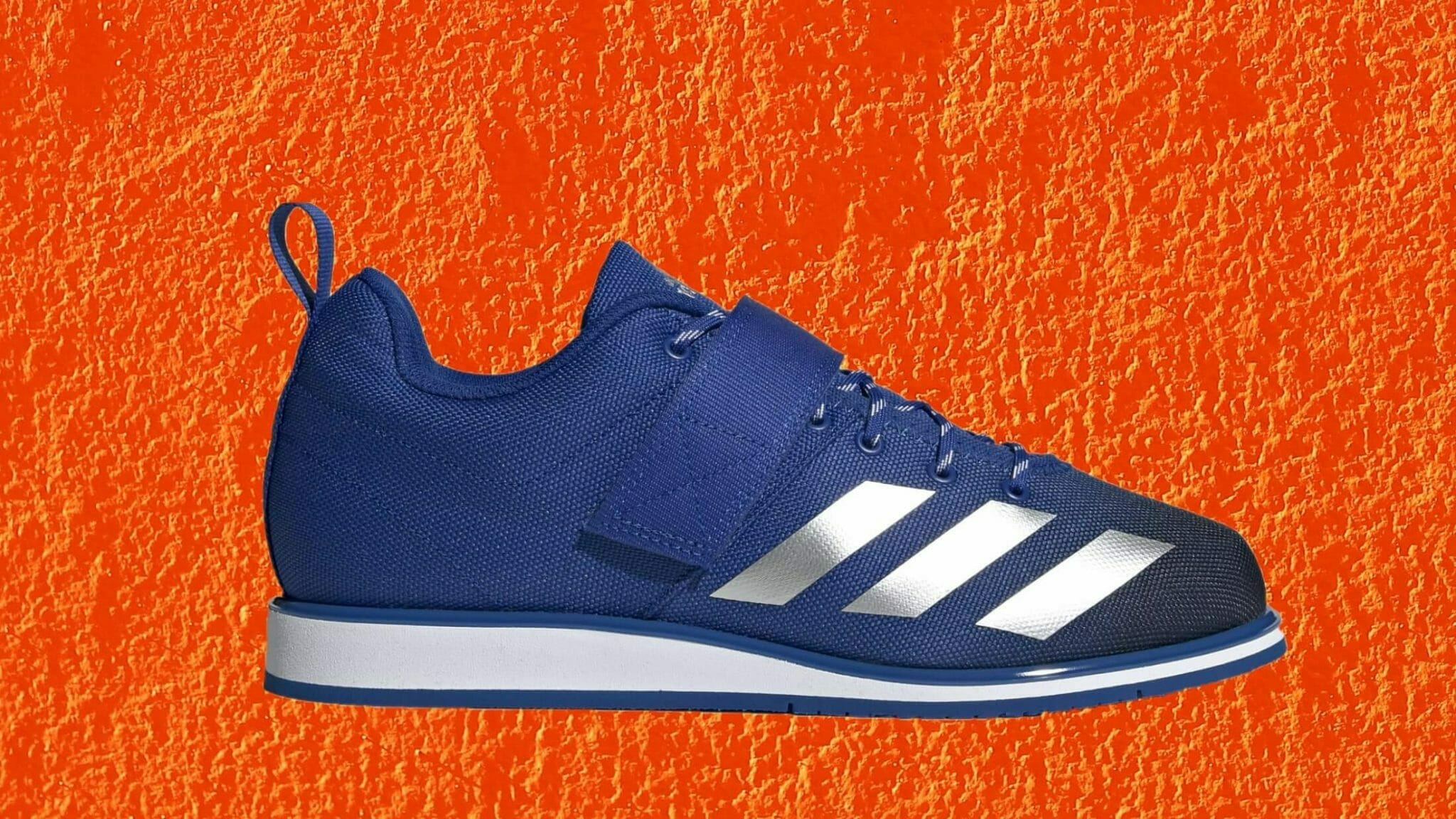 adidas Powerlift blue and silver metallic on orange background. Formerly known as the Powerlift 4.